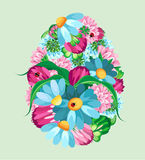 Dirigez l'oeuf des fleurs sur un fond en pastel Photo libre de droits