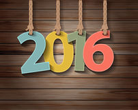 Dirigez la carte de voeux de papier de la nouvelle année 2016 sur la texture en bois illustration stock