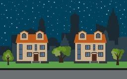 Dirigez la ville avec deux maisons à deux étages de bande dessinée et arbres verts la nuit Image stock