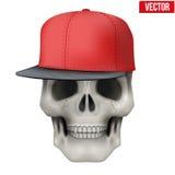 Dirigez le crâne humain avec le chapeau de coup sec et dur sur la tête Photo stock
