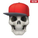 Dirigez le crâne humain avec le chapeau de coup sec et dur sur la tête Photo libre de droits