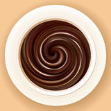 Dirigez le fond du chocolat chaud mélangé dans une cuvette Photos stock