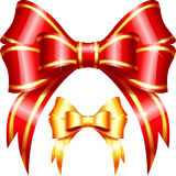 Dirigez le rouge et l'arc et le ruban de cadeau d'or Image stock