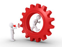 Dirigez les cris à l'employé à l'intérieur d'une roue dentée Image stock