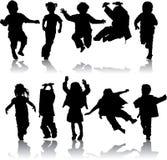 Dirigez les filles et les garçons de silhouette Photographie stock libre de droits