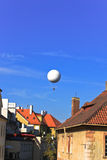 Dirigible balloon on the blue sky Stock Photography