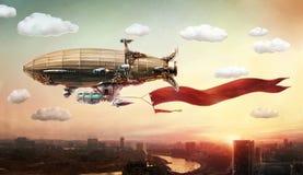 Dirigible med ett baner, i himlen över en stad Royaltyfri Bild