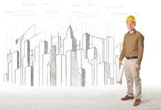 Dirija al hombre con el dibujo de la ciudad del edificio en fondo Foto de archivo libre de regalías