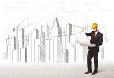 Dirija al hombre de negocios con el dibujo de la ciudad del edificio en fondo Fotografía de archivo libre de regalías