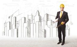 Dirija al hombre de negocios con el dibujo de la ciudad del edificio en fondo Imágenes de archivo libres de regalías
