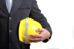Dirija a la gente que sostiene el sombrero de seguridad para el trabajo su proyecto Imagen de archivo
