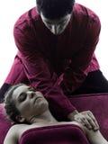 Dirija la silueta de la terapia del masaje Fotografía de archivo libre de regalías
