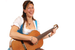 Dirndl and guitar Royalty Free Stock Images