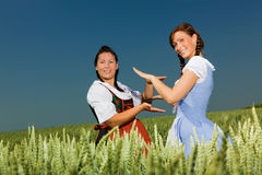 Dirndl playing Stock Photo