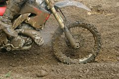 Dirt. Motorcycle race on a cross-country terrain Stock Photos