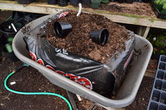 Dirt bag in a wheelbarrow. In a nursery Stock Photos