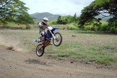 Dirt Bike. A dirt biker getting a little air stock photography