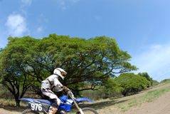 Dirt Bike. Close view of a dirt biker riding right by the camera royalty free stock image