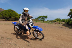 Dirt Bike. A dirt biker taking a turn at high speed Royalty Free Stock Photos