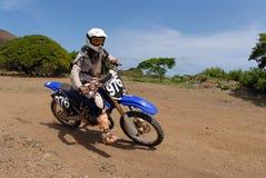Dirt Bike. A dirt biker taking a turn at high speed royalty free stock photos
