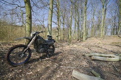 Dirt bike in forest Royalty Free Stock Image
