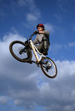 Dirt Bike Jump. Man make a big jump with a bike, like he's flying Royalty Free Stock Images