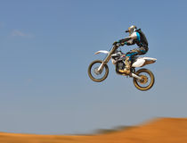 Dirt Bike Jumping - Panning Stock Photo