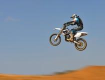 Dirt Bike Jumping - Panning stock photo