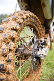 Dirt Bike Muddy Tire. Dirt bike after a had day of riding Royalty Free Stock Photos