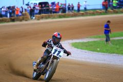 Dirt bike racer on the course Royalty Free Stock Photos