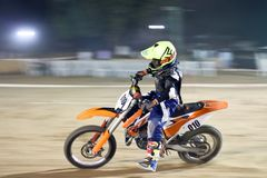 The Dirt bike racer India. Ducati has sponsored the dirt bike race event held in Ahmadabad, India for the first time. It was fastest track rout in India. Bikers Royalty Free Stock Photo