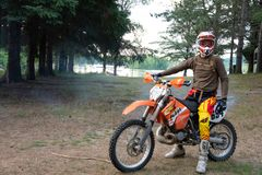 Dirt bike rider on his KTM 200 EXC motorbike. Dirt bike rider out in the country up north in Ontario, Canada, dirt bike riding on his KTM 200 . Leisurely ride stock image