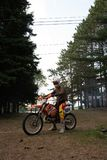 Dirt bike rider on his KTM 200 EXC motorbike. Dirt bike rider out in the country up north in Ontario, Canada, dirt bike riding on his KTM 200 . Leisurely ride royalty free stock image
