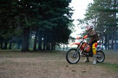 Dirt bike rider on his KTM 200 EXC motorbike. Dirt bike rider out in the country up north in Ontario, Canada, dirt bike riding on his KTM 200 . Leisurely ride Stock Photography
