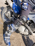 Dirt bike rider leg. Leg of a dirt bike rider, heavy, protective boot stock photography