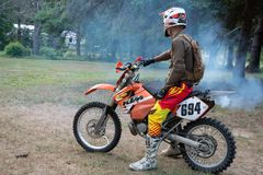 Dirt bike rider on his KTM 200 EXC motorbike. Dirt bike rider out in the country up north in Ontario, Canada, dirt bike riding on his KTM 200 . Leisurely ride royalty free stock images