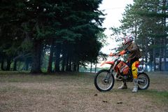 Dirt bike rider on his KTM 200 EXC motorbike. Dirt bike rider out in the country up north in Ontario, Canada, dirt bike riding on his KTM 200 . Leisurely ride royalty free stock photo