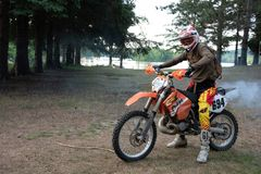 Dirt bike rider on his KTM 200 EXC motorbike. Dirt bike rider out in the country up north in Ontario, Canada, dirt bike riding on his KTM 200 . Leisurely ride royalty free stock photography