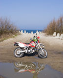 Dirt bike at sea Stock Photo