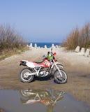 Dirt bike at sea stock photo