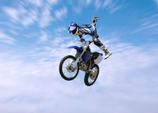 Dirt Bike Stunt Rider. A stunt rider doing tricks on his dirt bike stock photos