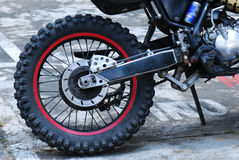 Dirt Bike Wheel. A photo taken on the rear wheel of a cross country dirt bike Stock Photo