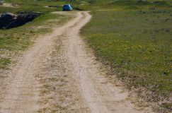 Dirt country road on the meadow Royalty Free Stock Photography