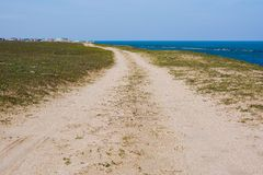Dirt country road on the seashore Stock Image