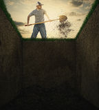 Dirt into a grave. A man used a shovel to throw dirt into an empty grave Stock Images