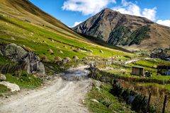 Dirt gravel broken road in mountains royalty free stock photography