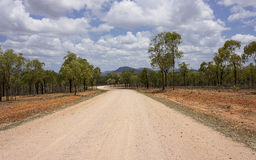 Country Road in Australia. Dirt road in Queensland Australia leading to the mountains Royalty Free Stock Images