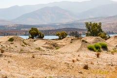 Dirt Moguls for BMX Race Training Near Otay Lake. CHULA VISTA, CALIFORNIA - JUNE 30, 2017:  BMX dirt moguls with a view of Otay Lake at the Chula Vista Elite Stock Photos