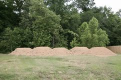 Dirt Mounds. On an empty lot being prepped for the building of a new home Stock Photos
