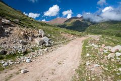 Dirt mountain road. Kyrgyzstan Royalty Free Stock Images